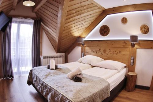 Łóżko lub łóżka w pokoju w obiekcie Willa Palider
