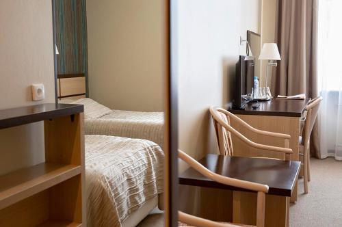 Кровать или кровати в номере Гранд Отель Восток