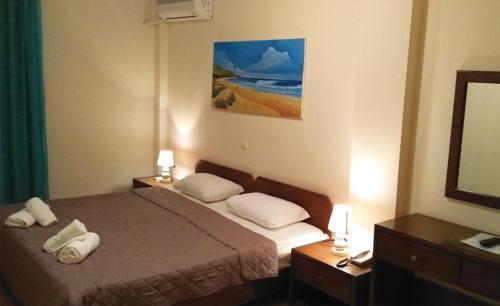 Ένα ή περισσότερα κρεβάτια σε δωμάτιο στο Ξενοδοχείο Αρέθουσα