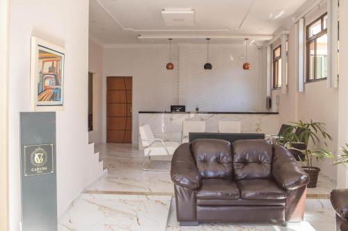 Uma área de estar em Gabvini Hotel