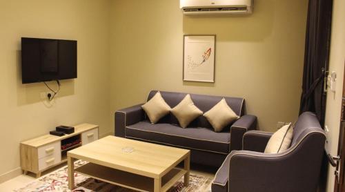 Uma área de estar em شارع الأمير مشاري بن سعود,المنصورة,الرياض السعودية