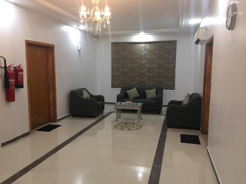 Uma área de estar em شقق منازل نور ببني عمرو شمال النماص
