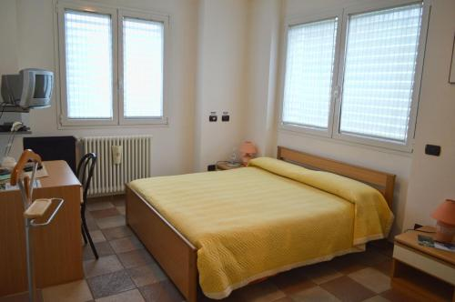 A bed or beds in a room at Bed & Breakfast Valtellina