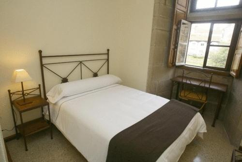 Cama o camas de una habitación en Hospedería San Martín Pinario