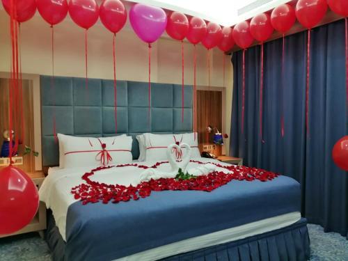Cama ou camas em um quarto em Swiss Blue Hotel
