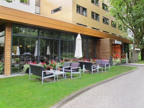 Een restaurant of ander eetgelegenheid bij Fletcher Wellness-Hotel Stadspark