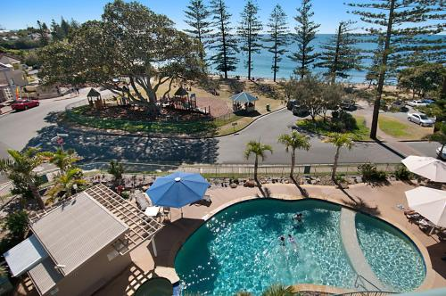 A view of the pool at The Norfolks on Moffat Beach or nearby
