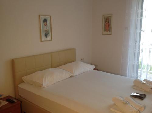 Ein Bett oder Betten in einem Zimmer der Unterkunft Bed & Breakfast Batosic Makarska