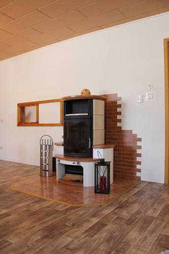 """A television and/or entertainment center at Landhaus """"Zum Frosch"""""""