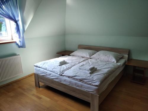 Posteľ alebo postele v izbe v ubytovaní Ubytovanie pri Kúpeľoch