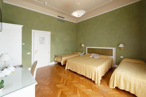 Letto o letti in una camera di Hotel Gennarino