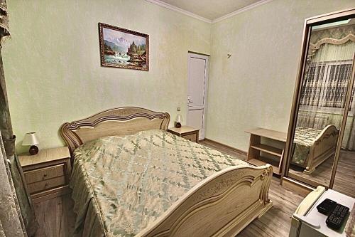 Кровать или кровати в номере Romantika