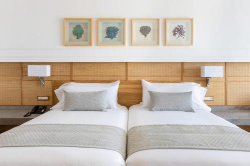 سرير أو أسرّة في غرفة في Hotel Riu Palace Tikida Taghazout - All Inclusive