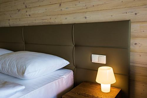 Кровать или кровати в номере Sand Martin