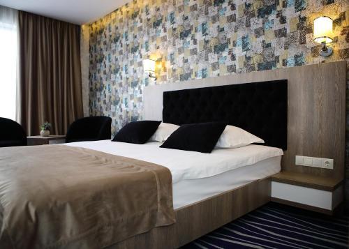 Un pat sau paturi într-o cameră la MELISS EVENTS