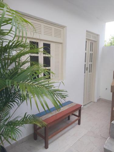 A seating area at Flat quarto e sala, mobiliado 100 mts PRAIA e VILA, Rua da caixa econômica Federal