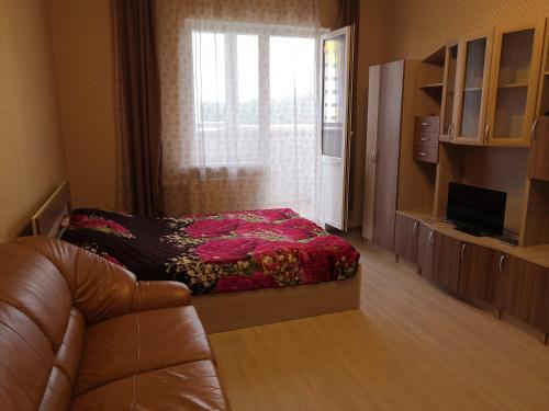 Кровать или кровати в номере Апартаменты-студио на Фрунзе 2