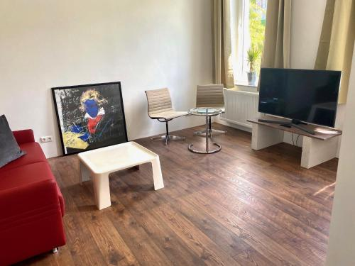 A television and/or entertainment centre at Chez Coco Apartment 2 Aachen