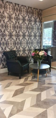 A seating area at Best Western New Kent Hotel