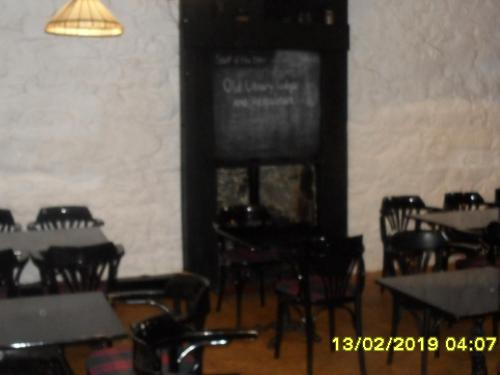 A restaurant or other place to eat at The Old Library & Lodge