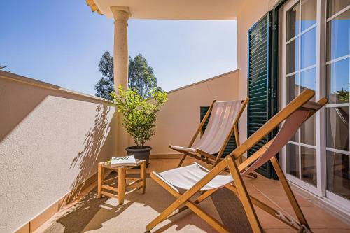 A balcony or terrace at Buganvilias Do Meco Guest house