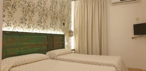 Cama o camas de una habitación en Hostal Macami