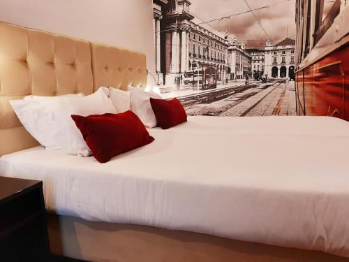 A bed or beds in a room at Lisbon City Apartments & Suites by City Hotels