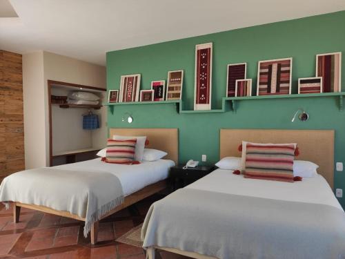 Cama o camas de una habitación en Hotel Rosario Lago Titicaca