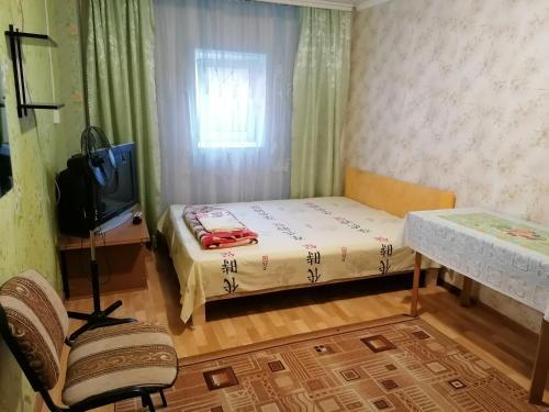 Кровать или кровати в номере Guest house U Iriny