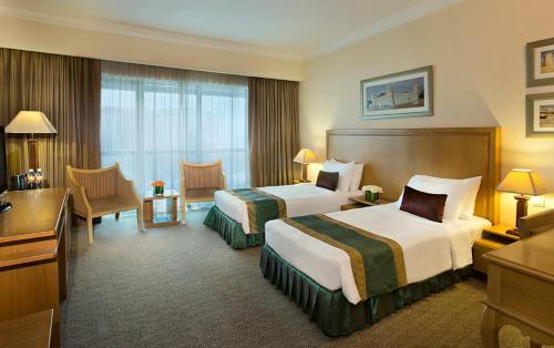 Кровать или кровати в номере City Seasons Hotel Dubai