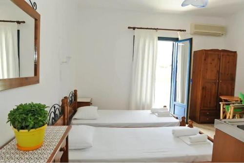 A bed or beds in a room at Morfeas Hotel