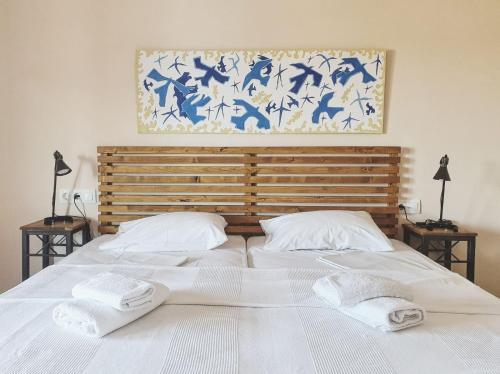 Ένα ή περισσότερα κρεβάτια σε δωμάτιο στο Ammon Garden Hotel