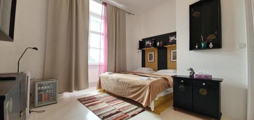 A bed or beds in a room at Zámek Napajedla