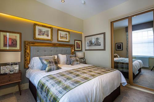 A bed or beds in a room at The Rutland Arms Hotel, Bakewell, Derbyshire