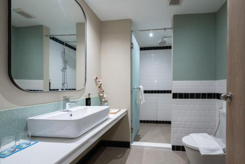 A bathroom at The Cotton Saladaeng Hotel