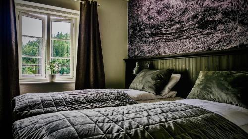 En eller flere senger på et rom på Fosen Fjord Hotel