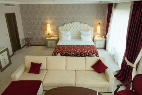 Кровать или кровати в номере Отель Грозный Сити