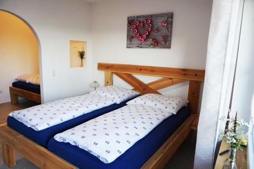 Ein Bett oder Betten in einem Zimmer der Unterkunft Gradlhof