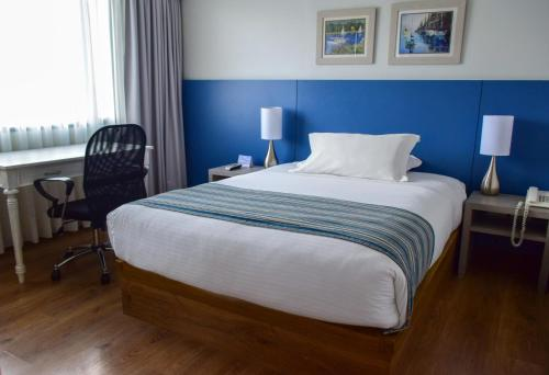 A bed or beds in a room at Hotel Saint Simon
