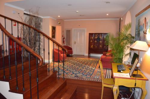 The lobby or reception area at Residencial Mariazinha by Petit Hotels