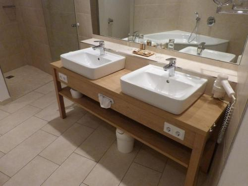Ein Badezimmer in der Unterkunft Landhotel Jann Hinsch Hof