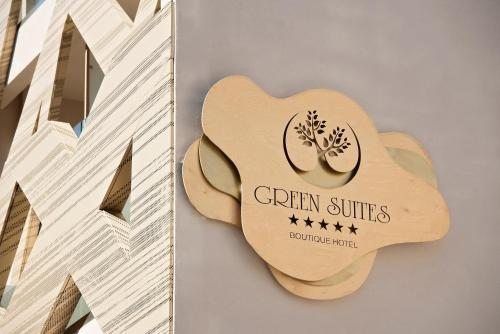 A certificate, award, sign, or other document on display at Green Suites Boutique Hotel