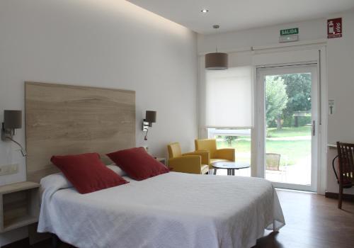 Una habitación en Hotel Rural O Acivro