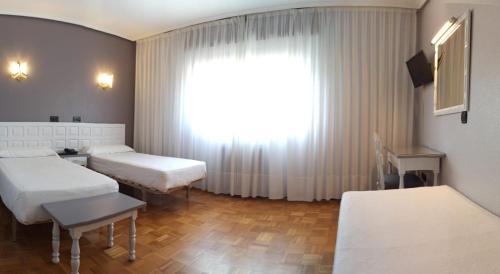 Cama o camas de una habitación en Hotel Las Vegas