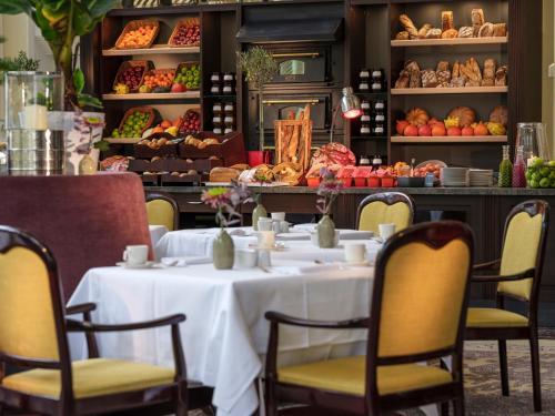 Ein Restaurant oder anderes Speiselokal in der Unterkunft Parkhotel Bremen – ein Mitglied der Hommage Luxury Hotels Collection
