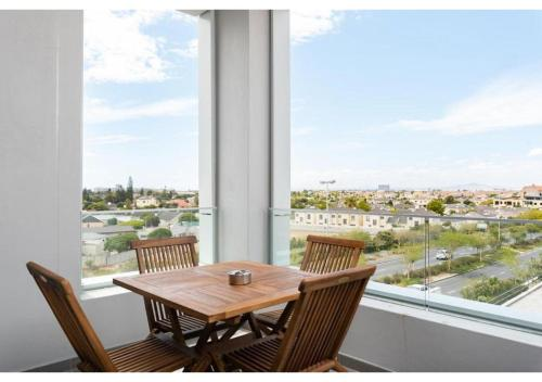 A balcony or terrace at Axis Luxury Apartments