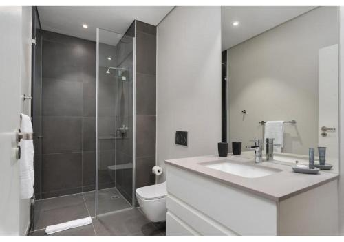 A bathroom at Axis Luxury Apartments