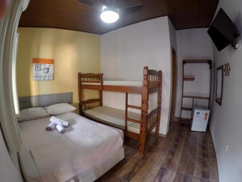 A bunk bed or bunk beds in a room at Ilha Grande Mar