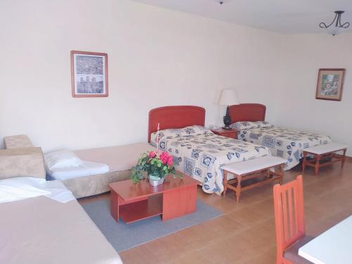Una habitación en Villa Caltengo