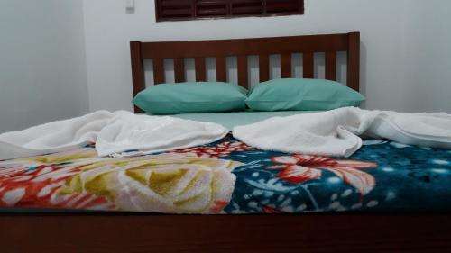 A bed or beds in a room at Casa Familía